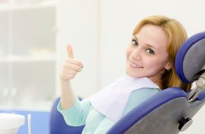 Woman happy because she chose the dentist lisle residents love.