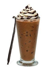 tall glass of coffee swirls straw