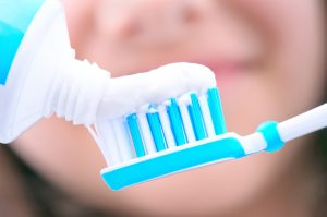 Toothpaste being put on a toothbrush
