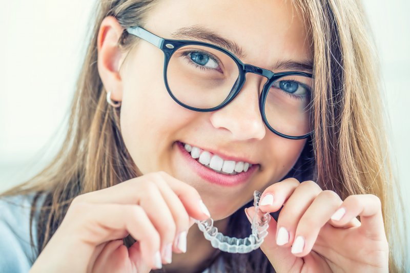 Young woman with Invisalign from dentist in Lisle