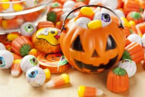 Halloween pail and candy recommended by Lisle dentist
